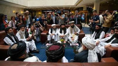 Mullah Abdul Ghani Baradar, the Taliban group's top political leader, left, Sher Mohammad Abbas Stanikzai, the Taliban's chief negotiator, second left, and other members of the Taliban delegation speak to reporters prior to their talks in Moscow, Russia, Tuesday, May 28, 2019.